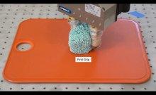 robotic fingers shaping foam simulating sushi rice