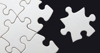white puzzle pieces with one piece not assembled