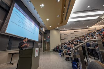Dr. Amnon Shashua presenting in a lecture hall