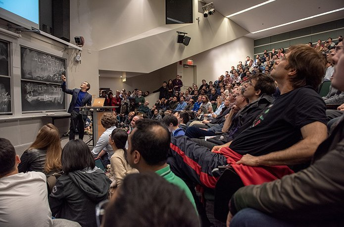 Dr. Demis Hassabis presenting in lecture hall at MIT