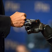 a robot and human fist bump