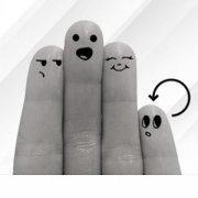 fingers with faces drawn on them interacting