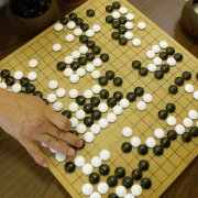 Photo of two people playing Go, a game of strategy. Photograph: Cheryl Hatch/AP