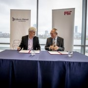 MIT and Liberty Mutual Insurance announced a $25 million, five-year collaboration to support intelligence research at a meeting on Tuesday attended by Liberty Mutual Chairman and CEO David Long (left) and MIT President L. Rafael Reif.  Photo: Rose Lincoln
