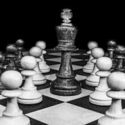 black and white photo of chess pieces on a board